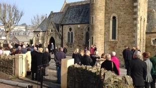People gather for the funeral of PC Hocking