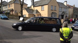 The funeral procession leaves