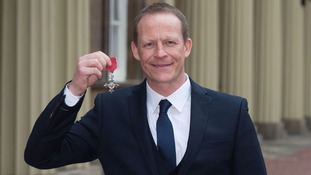 Mr Hill in the grounds of Buckingham Palace after being made an MBE.