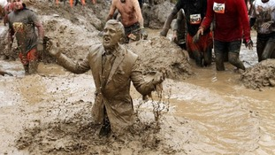 Participant gets his suit covered in the Mud Mile obstacle