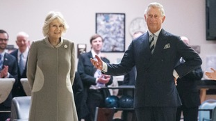 Prince Charles looks dismayed after hitting only three pins