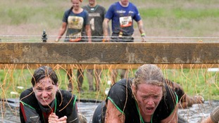 Participants pass through the Electric Eel obstacle