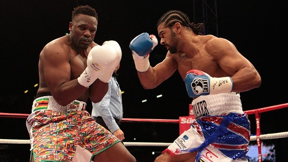 David Haye (right) in action against Dereck Chisora in their WBA and WBO International Heavyweight Championship bout at Upton Park, London.