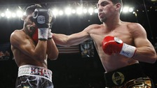 Khan takes a punch from Garcia.