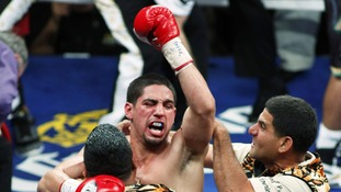 Garcia celebrates his fourth-round victory over Khan.