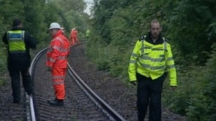 Workers on railway tracks