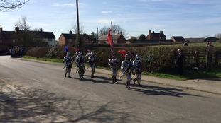 Seven men-at-arms march into Sutton Cheney ahead of the hearse
