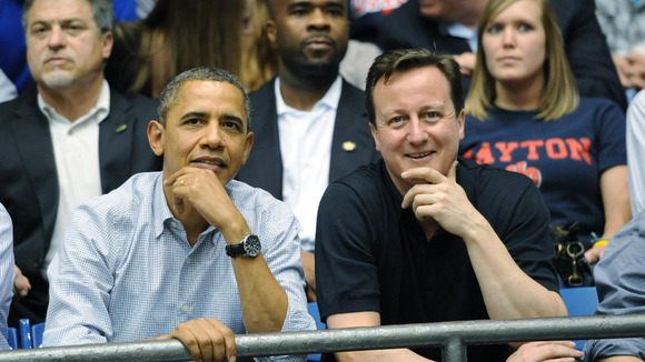 Prime Minister David Cameron and US President Barack Obama in Ohio as they watch a basketball game