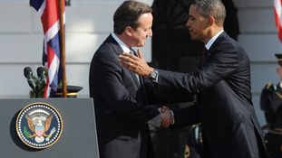 Prime Minister David Cameron and US President Barack Obama greet each other at the official welcoming ceremony