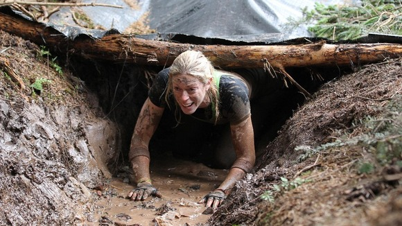 A participant tackles the Trench Warfare obstacle