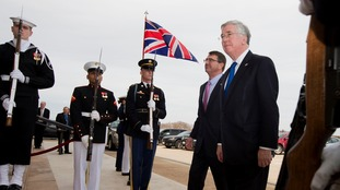 Defense Secretary Michael Fallon (right).