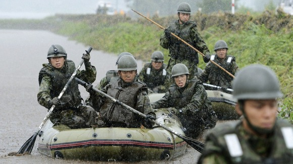Japan Self-Defence Force soldiers search for missing people at an area hit by landslides caused by heavy rains in Aso, Kumamoto prefecture.