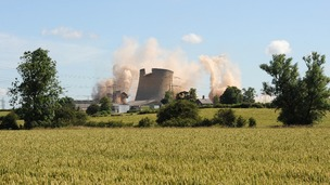The High Marnham cooling towers in Nottinghamshire during their demolition.