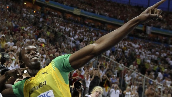 Usain Bolt does his traditional celebration