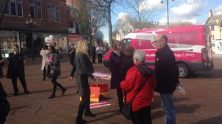 The pink bus was in the city centre.