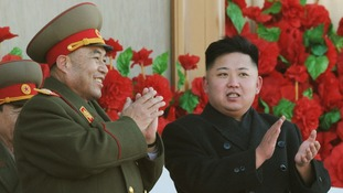North Korean leader Kim Jong-Un with Ri Yong-ho.