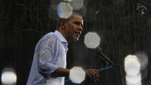 A soaked Obama speaks at a rally in Virginia.