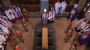 The coffin was moved into position to the sound of a specially-composed anthem
