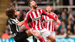 Newcastle's Fabricio Coloccini and Sunderland's Steven Fletcher during the last derby match at St. James' Park, December 21, 2014.