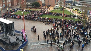 Hundreds of people watching the service on a big screen in Leicester's Jubilee Square