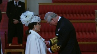 Dame Joan Collins receives her honour from the Prince of Wales