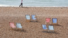 Empty deck chairs are seen on the beach in Brighton, East Sussex
