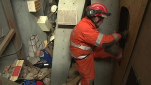 Rescuers battle their way through a simulated disaster to help victims
