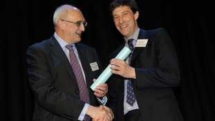 Dr Simon Learmount (right) receives his award