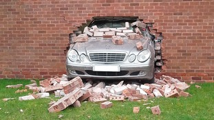 The car smashed through the wall of the MOT centre