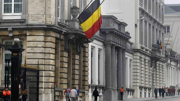Belgian flags fly at half mast outside the Belgian parliament in Brussels on a national day of mourning after the Swiss bus crash