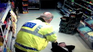 Video: Knife-wielding robber tasered by police