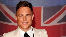 The singer Olly Murs slipped on some wet stairs during his performance at Guilfest.