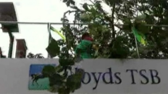 Olympic Torch bus collides with a low lying tree