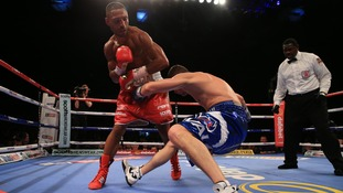 Kell Brook knocks down Jo Jo Dan during the IBF World Welterweight Championship bout at the Motorpoint Arena
