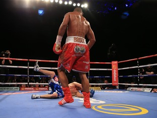 Brook knocks down Jo Jo Dan during the IBF World Welterweight Championship defence
