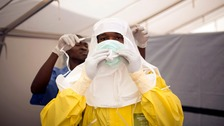 Health workers put on protective gear