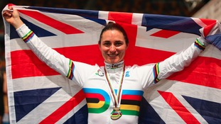 Sarah Storey holds the Union flag aloft with her gold medal.