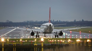 A passenger plane prepares for take off at Gatwick Airport