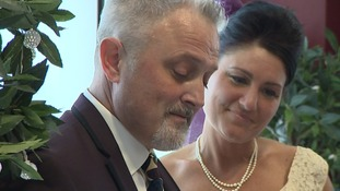 Couple walk down the aisle... in their local supermarket