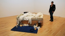 Tracey Emin wipes away tears unveiling £2.54m unmade bed.