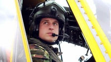 Prince William at the controls of a Sea King helicopter which he used to fly in Anglesey.