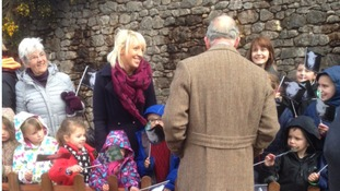 Members of the public smiled as they spoke with Prince Charles