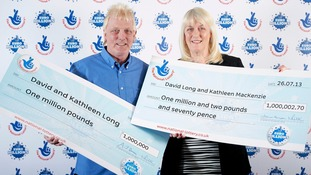 David and Kathleen Long with their two £1 million cheques.