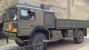 The military arrive at the disused warehouse building which is currently being cleaned