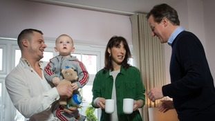 David Cameron and his wife Samantha meet first time home buyer Robert Arron.