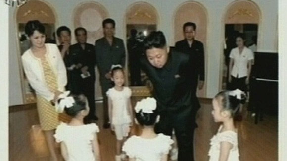 North Korean leader Kim Jong-un visits a pre-school with a female companion