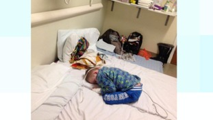 Disabled boy sleeps on hospital floor