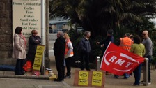 Members of the RMT union demonstrate outside Penzance railway station