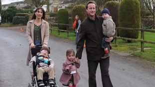 The Camerons pictured in 2009 with their children