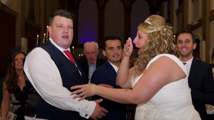 The moment Danielle Jones and her new husband Darrel realised who was there.